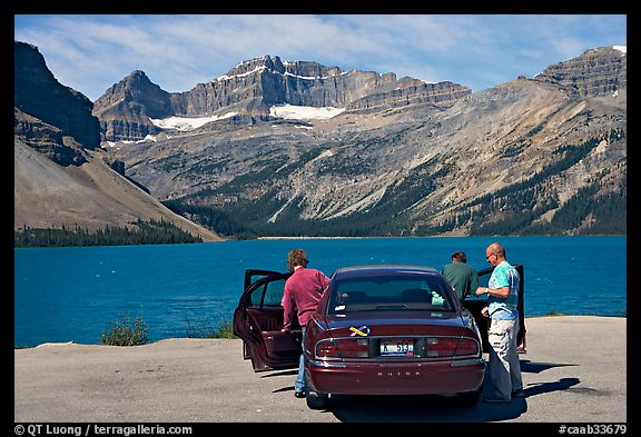 Visitors stepping out of a car next to Bow Lake. Banff National Park, Canadian Rockies, Alberta, Canada (color)