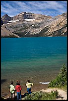 Family standing on the shores of Bow Lake. Banff National Park, Canadian Rockies, Alberta, Canada (color)