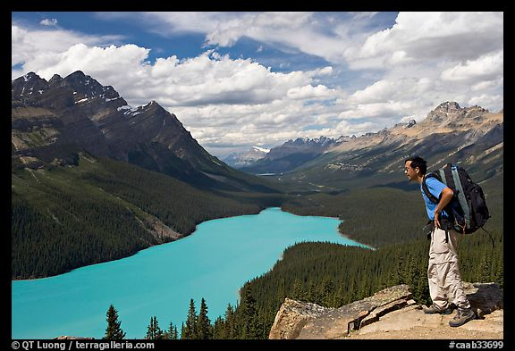 Hiker wearing backpack looking at Peyto Lake. Banff National Park, Canadian Rockies, Alberta, Canada (color)