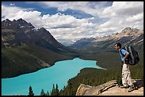 Hiker wearing backpack looking at Peyto Lake. Banff National Park, Canadian Rockies, Alberta, Canada