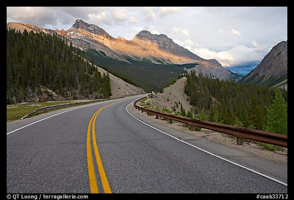 Twisting road, Icefields Parkway, sunset. Banff National Park, Canadian Rockies, Alberta, Canada