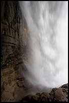 Curtain of water of Panther Falls, seen from behind. Banff National Park, Canadian Rockies, Alberta, Canada
