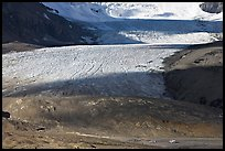 Base of Athabasca Glacier with cars parked on lot. Jasper National Park, Canadian Rockies, Alberta, Canada ( color)