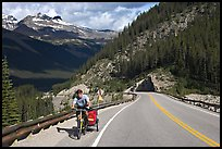 Cyclist with tow, Icefieds Parkway. Jasper National Park, Canadian Rockies, Alberta, Canada (color)