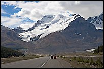 Cyclists on the Icefields Parkway at the base of Mt Athabasca. Jasper National Park, Canadian Rockies, Alberta, Canada