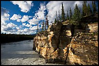 Cliff and Athabasca River, late afternoon. Jasper National Park, Canadian Rockies, Alberta, Canada (color)