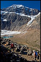 Hikers on trail below the face of Mt Edith Cavell. Jasper National Park, Canadian Rockies, Alberta, Canada (color)
