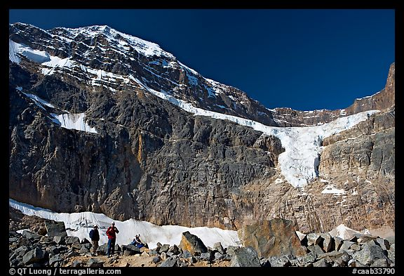 Hikers on a moraine below Mt Edith Cavell, morning. Jasper National Park, Canadian Rockies, Alberta, Canada (color)
