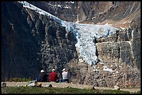 Hikers looking at a hanging glacier on  Mt Edith Cavell. Jasper National Park, Canadian Rockies, Alberta, Canada (color)