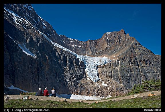 Hikers look at Angel Glacier, late morning. Jasper National Park, Canadian Rockies, Alberta, Canada (color)