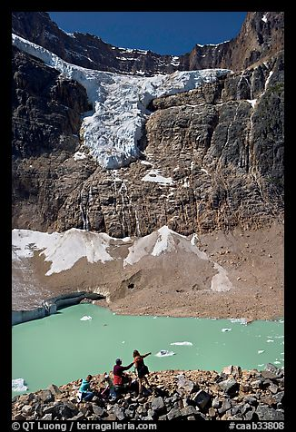 Family looking at Cavell Pond and Angel Glacier. Jasper National Park, Canadian Rockies, Alberta, Canada