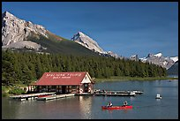Boat house and canoe beneath Leh and Samson Peaks,  Maligne Lake. Jasper National Park, Canadian Rockies, Alberta, Canada (color)