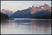 Peaks reflected in rippled water, Maligne Lake, sunset. Jasper National Park, Canadian Rockies, Alberta, Canada