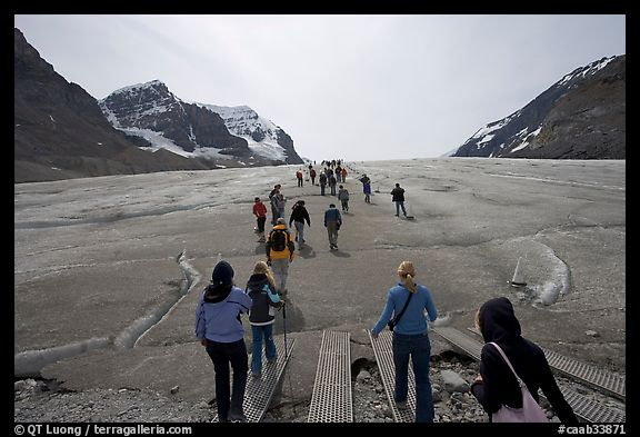 Visitors walking onto  Athabasca Glacier. Jasper National Park, Canadian Rockies, Alberta, Canada (color)