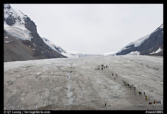 Toe of Athabasca Glacier with tourists in delimited area. Jasper National Park, Canadian Rockies, Alberta, Canada (color)