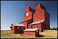 Red wooden grain elevator building. Alberta, Canada