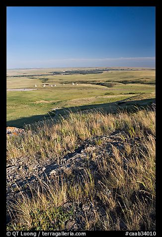 Prairie and teepees from the top of the cliff, Head-Smashed-In Buffalo Jump. Alberta, Canada (color)