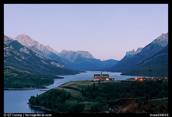 Prince of Wales hotel over Waterton Lakes, dusk. Waterton Lakes National Park, Alberta, Canada (color)