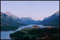 Prince of Wales hotel over Waterton Lakes, dusk. Waterton Lakes National Park, Alberta, Canada