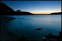 Boulders in Waterton Lake and Prince of Wales hotel, dawn. Waterton Lakes National Park, Alberta, Canada (color)