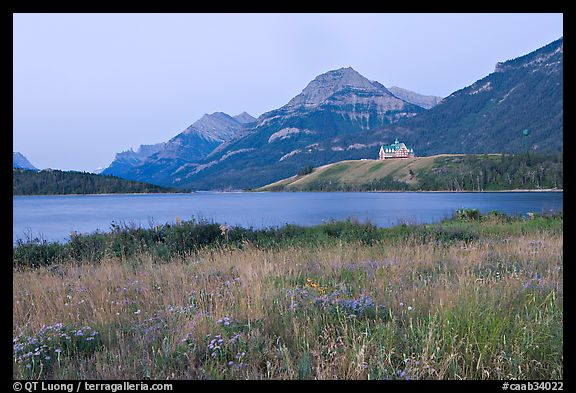 Prince of Wales hotel and upper Waterton Lake, dawn. Waterton Lakes National Park, Alberta, Canada (color)