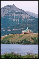 Prince of Wales hotel, lake and mountain, dawn. Waterton Lakes National Park, Alberta, Canada (color)