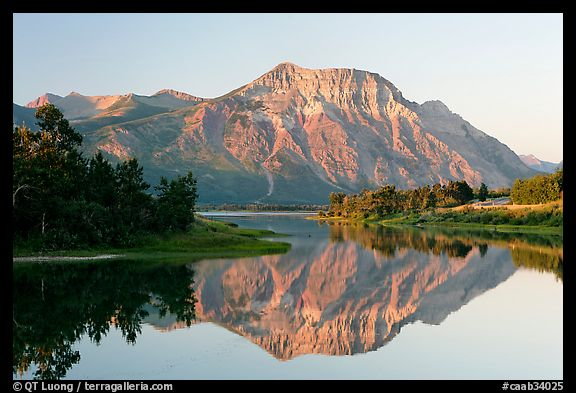 Vimy Peak reflected in Middle Waterton Lake, sunrise. Waterton Lakes National Park, Alberta, Canada (color)
