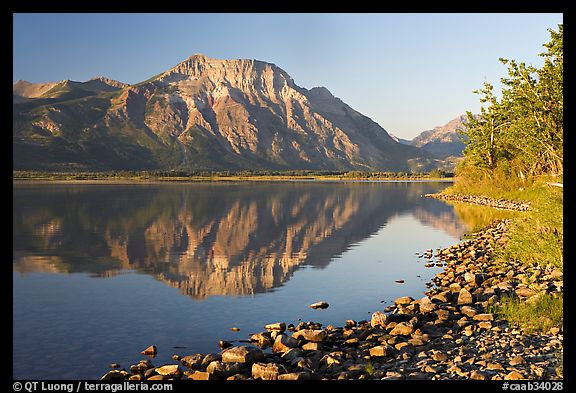Shoreline with pebbles, Middle Waterton Lake, and Vimy Peak. Waterton Lakes National Park, Alberta, Canada (color)