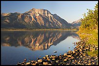 Shoreline with pebbles, Middle Waterton Lake, and Vimy Peak. Waterton Lakes National Park, Alberta, Canada