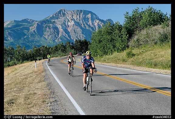 Cyclists on road. Waterton Lakes National Park, Alberta, Canada (color)