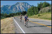 Cyclists on road. Waterton Lakes National Park, Alberta, Canada ( color)