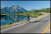 Cyclist next to Lower Waterton Lake. Waterton Lakes National Park, Alberta, Canada (color)