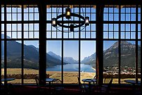 View over Waterton Lake through the windows of Prince of Wales hotel, morning. Waterton Lakes National Park, Alberta, Canada