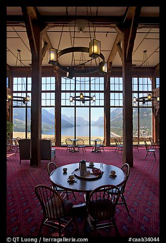 Table in lobby of Prince of Wales hotel with view over Waterton Lake. Waterton Lakes National Park, Alberta, Canada