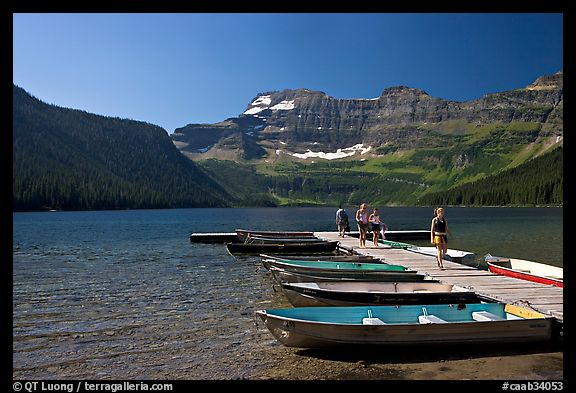 Dock and small boats, with tourists walking down, Cameron Lake. Waterton Lakes National Park, Alberta, Canada (color)