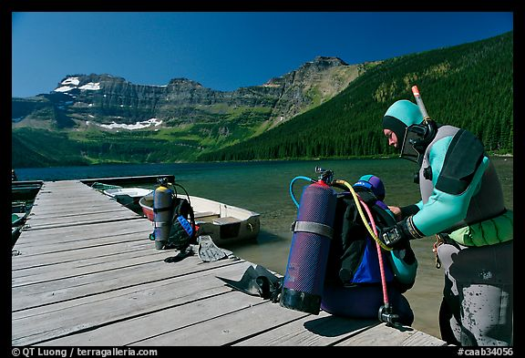 Scuba divers preparing to dive into cold waters of Cameron Lake. Waterton Lakes National Park, Alberta, Canada (color)