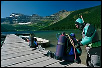 Scuba divers preparing to dive into cold waters of Cameron Lake. Waterton Lakes National Park, Alberta, Canada