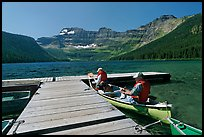Canoists parking to dock, Cameron Lake. Waterton Lakes National Park, Alberta, Canada