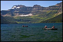 Canoists on Cameron Lake. Waterton Lakes National Park, Alberta, Canada