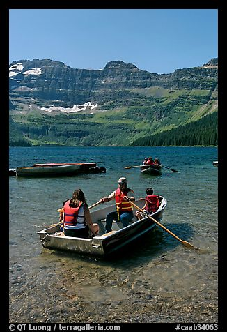 Families boating in Cameron Lake. Waterton Lakes National Park, Alberta, Canada (color)