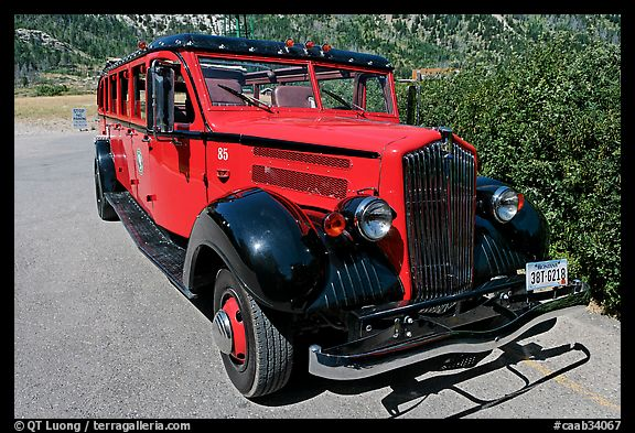 Red antique busses from Glacier National Park. Waterton Lakes National Park, Alberta, Canada