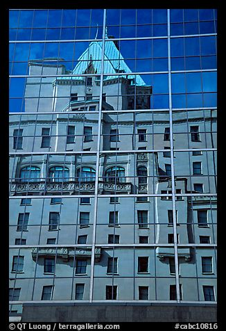 Buildings reflected in the glass windows of a high-rise buildings. Vancouver, British Columbia, Canada (color)