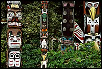 Totem collection, near the Capilano suspension bridge. Vancouver, British Columbia, Canada (color)