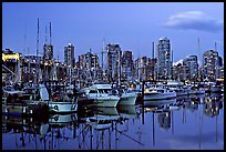 Small boat harbor and skyline at dusk. Vancouver, British Columbia, Canada (color)