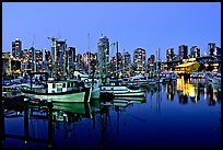 Fishing boats and skyline at night. Vancouver, British Columbia, Canada
