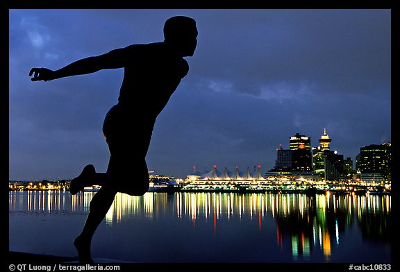 Harry Jerome (a former great sprinter)  statue and Harbor at night. Vancouver, British Columbia, Canada (color)