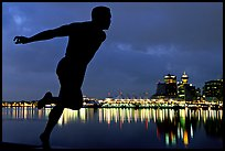 Harry Jerome (a former great sprinter)  statue and Harbor at night. Vancouver, British Columbia, Canada ( color)