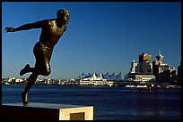 Runner's statue and Harbor center, late afernoon. Vancouver, British Columbia, Canada