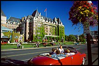 Red convertible car and Empress hotel. Victoria, British Columbia, Canada ( color)