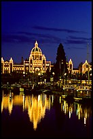 Parliament buildings lights reflected in the harbor. Victoria, British Columbia, Canada